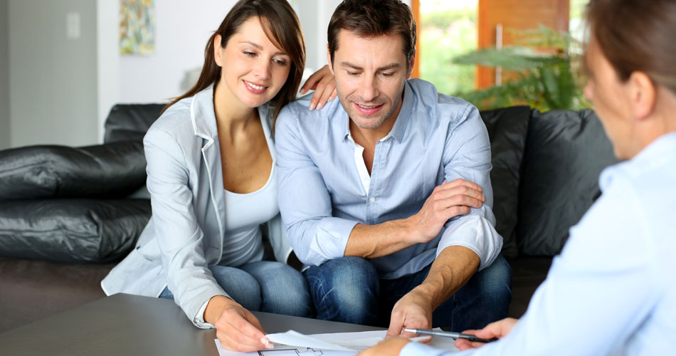 Buyers Reviewing Home Inspection